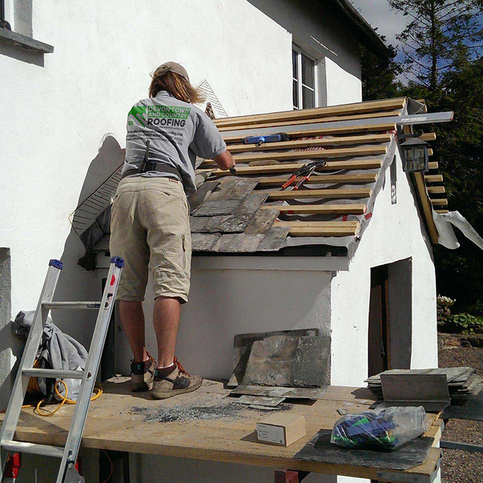 Devon Town & Country Roofing working on a porch roof